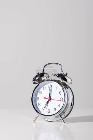 close-up view of shiny alarm clock on grey