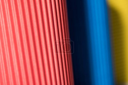 selective focus of colorful paper cups, full frame