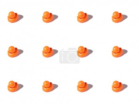 background with small orange rubber ducks on white