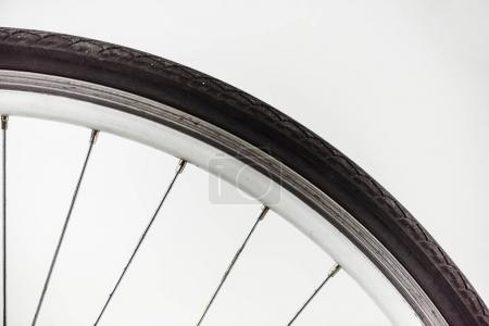 bicycle wheel with rim, tire and spokes isolated on white