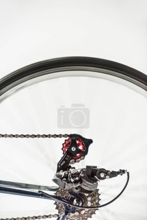 bicycle gears and wheel in motion isolated on white