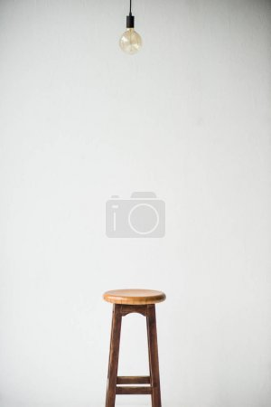 Photo for Wooden chair and lamp isolated on white - Royalty Free Image