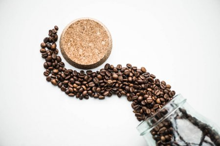 top view of wave from coffee beans and cork isolated on white