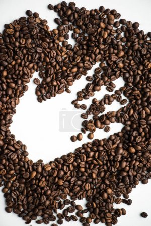 top view of hand sign from coffee beans isolated on white
