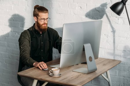 handsome businessman working with computer in office