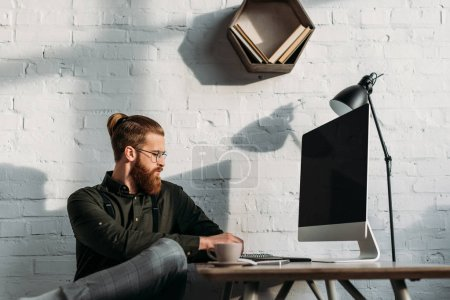 Photo for Side view of handsome businessman using computer in office - Royalty Free Image