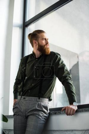 Photo for Bottom view of businessman standing and looking at window - Royalty Free Image
