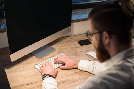 Photo for Businessman typing something on keyboard in office - Royalty Free Image