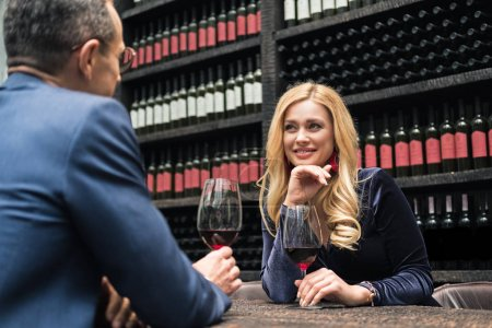 beautiful adult couple drinking wine at restaurant