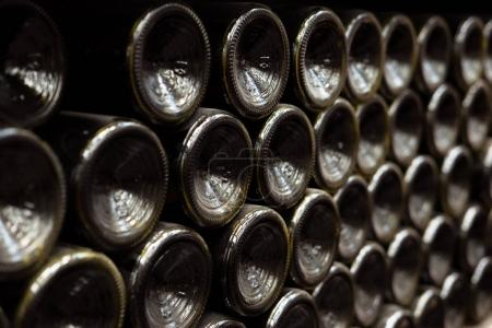 close up view of wall made of wine bottles