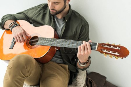 Photo for Handsome man playing acoustic guitar - Royalty Free Image