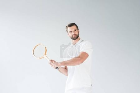 handsome tennis player with tennis racket isolated on white