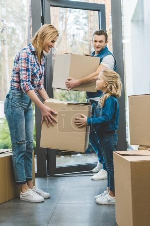 young family moving into new house