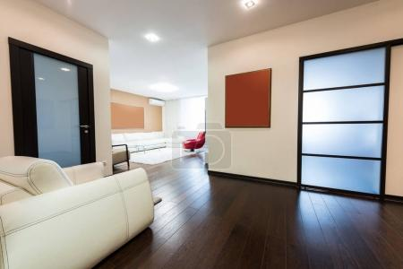 Photo for View of empty modern corridor with wooden floor - Royalty Free Image