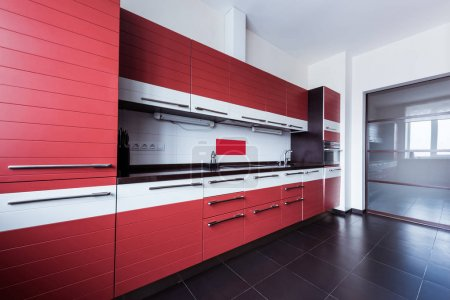Photo for View of empty modern kitchen in red color - Royalty Free Image