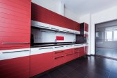 view of empty modern kitchen in red color