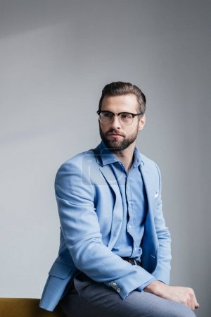 Photo for Stylish bearded man in glasses and blue trendy suit - Royalty Free Image