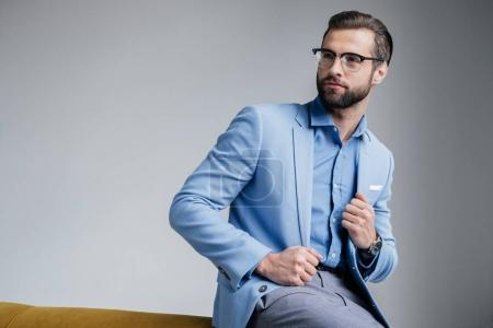 Photo for Stylish handsome man in eyeglasses and blue trendy suit - Royalty Free Image