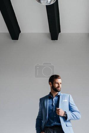 stylish man posing in blue trendy suit