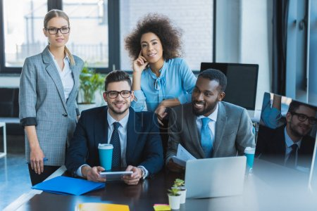 Photo for Smiling multicultural businesspeople looking at camera in office - Royalty Free Image