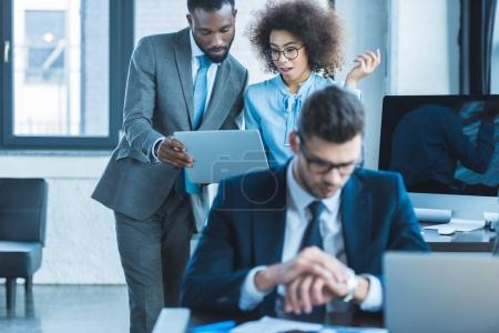 young multicultural businesspeople at work in office