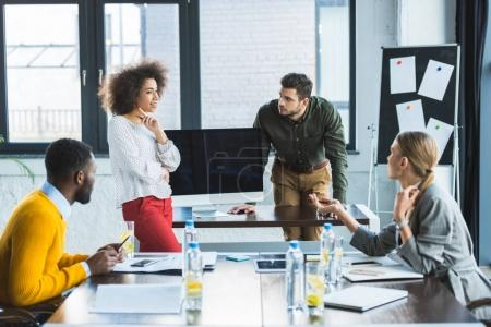 Photo for Multicultural young businesspeople at meeting in office - Royalty Free Image