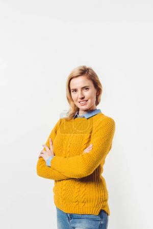 beautiful smiling woman with crossed arms on white