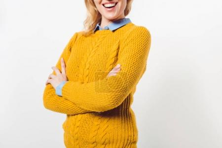 cropped shot of smiling woman with crossed arms on white