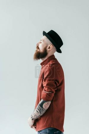 Photo for Side view of bearded handsome man standing with closed eyes isolated on white - Royalty Free Image