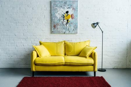 Photo for Interior of cozy living room with painting on wall, sofa and floor lamp beside - Royalty Free Image