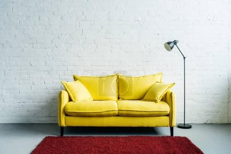 Photo for Interior of modern living room with rug, couch and floor lamp beside - Royalty Free Image