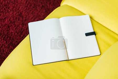 Top view of empty textbook pages with pencil