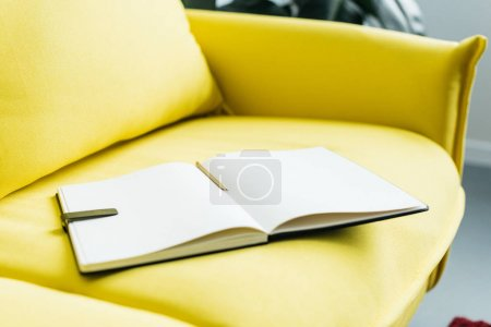 Photo for Close up view of empty textbook pages with pencil - Royalty Free Image
