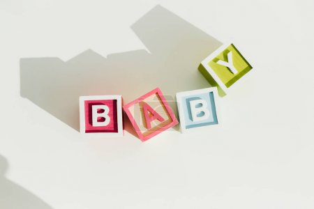 Top view of word baby on letter wooden blocks