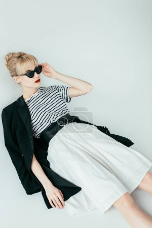 Fashionable blonde girl wearing black and white clothes