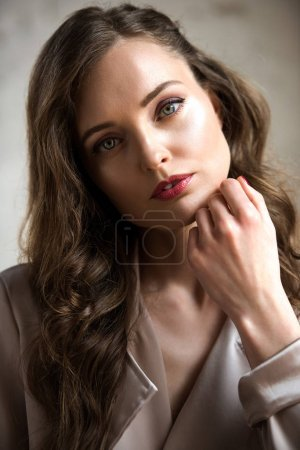 portrait of attractive woman with long hair looking at camera
