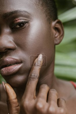 portrait of fashionable african american woman with glitter eyeshadow