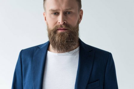 Confident bearded man isolated on light background