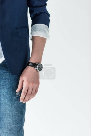 Close-up view of watch on male hand isolated on light background