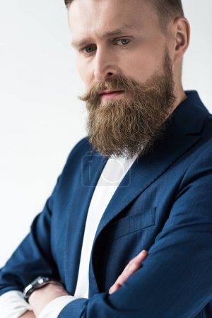 Stylish bearded man in blue jacket isolated on light background