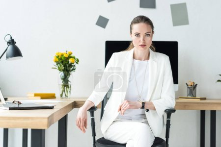 Photo for Portrait of beautiful businesswoman in white suit at workplace in office - Royalty Free Image