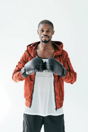 Photo for Sportive african american man in boxing gloves, isolated on white - Royalty Free Image