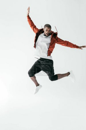 Photo for Excited african american man jumping in sportswear, isolated on white - Royalty Free Image