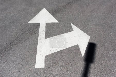 Photo for Traffic arrows painted white on asphalt road - Royalty Free Image