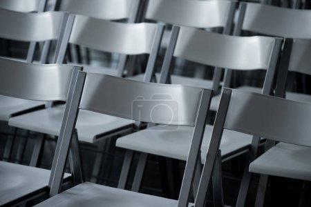 close up view of arranged empty modern chairs