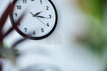 selective focus of black and white clock hanging on wall