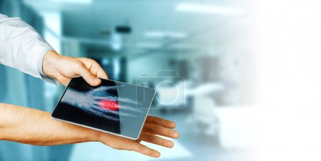 Doctor Hand With Digital Tablet Scans Patient Hand, Medicine Technology Concept