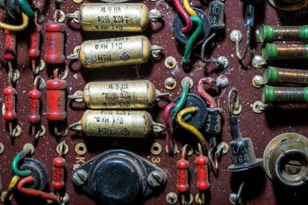 Photo for Different microchips and transistors on an old circuit board - Royalty Free Image