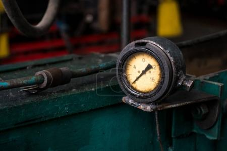 old pressure gauge on the pipeline