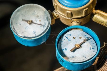 Old pressure gauge on the pipeline, Closeup of man...
